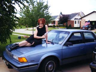 Courtney on the hood of a Buick