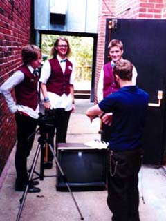 Bustin' up a TV in the alley with Mort BURKE, Brendan McMULLAN, and Matt McLAUGHLIN