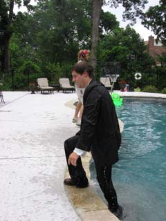 Todd, trudging as only a dude in a suit that just jumped in a swimming pool can trudge