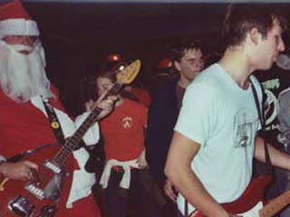 RØB Santa Clausin' it up at the STLPunk benefit, December 21, 2002