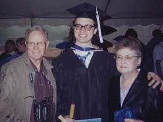 Again at college graduation, this time flanked by his father's parents