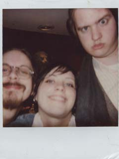 Polaroid of RØB with some girl named Christine or something, and some guy named Kato or something, at some rich guy named Marty's mansion, in January of 2003