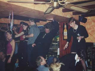 RØB wailin' at JJ's in Brussels, Belgium; New Year's Eve 2000-2001, while Andrew gets fresh in the background